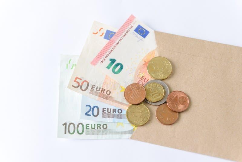 Eurosedlar och mynt på vit bakgrund royaltyfri fotografi