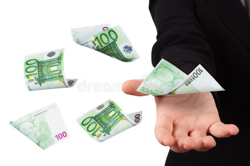 Eurosedlar på ung affärskvinna fotografering för bildbyråer