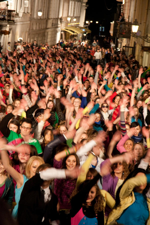 Eurovision flash mob dance moments. Big crowed dancing 2010 Eurovision flash mob dance in Vilnius oldtown royalty free stock photography