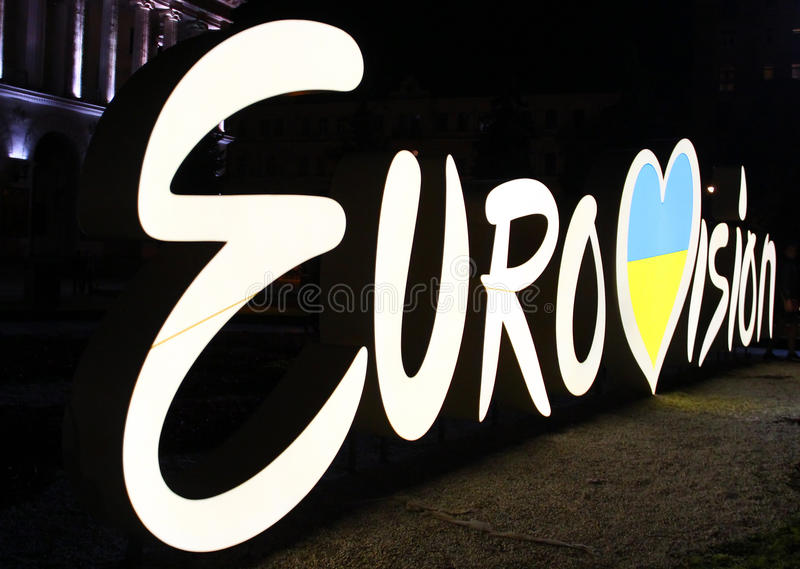 Eurovision logo in the center of Kyiv, Ukraine. KYIV, UKRAINE - MAY 5, 2017: Eurovision logo at night located on Independence square Maidan Nezalezhnosti in the royalty free stock photos