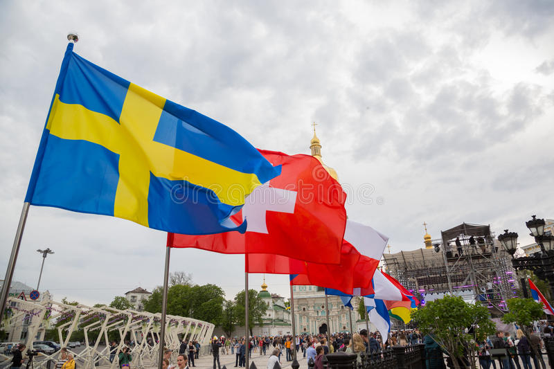 Eurovision song contest fan zone. KYIV, UKRAINE - APRIL 30, 2017: Different flags on Sofiivska Square near Eurovision song contest fan zone in Kyiv, Ukraine stock photos