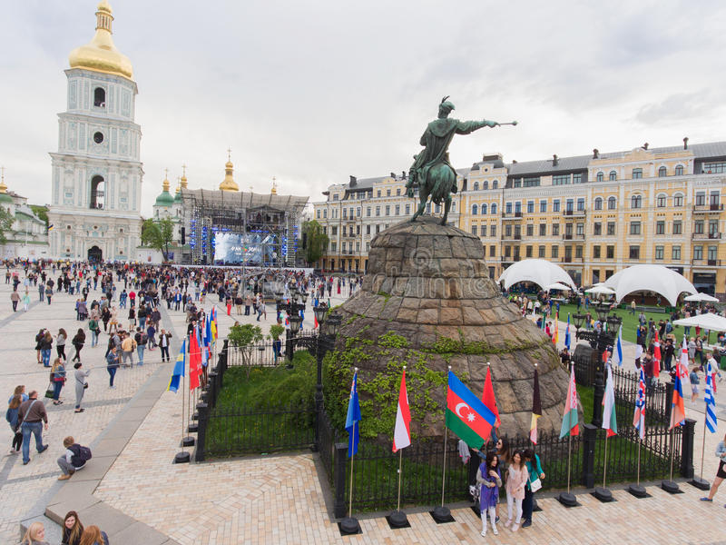 Eurovision song contest fan zone. KYIV, UKRAINE - APRIL 30, 2017: People walking on Sofiivska Square near Eurovision song contest fan zone in Kyiv, Ukraine royalty free stock image