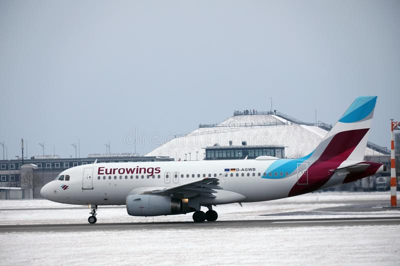 Eurowings Airbus A319-100 D-AGWB landing in Munich Airport. Eurowings Airbus A319-100 D-AGWB landed in Munich Airport, winter time with snow on runway, Besucherh royalty free stock image