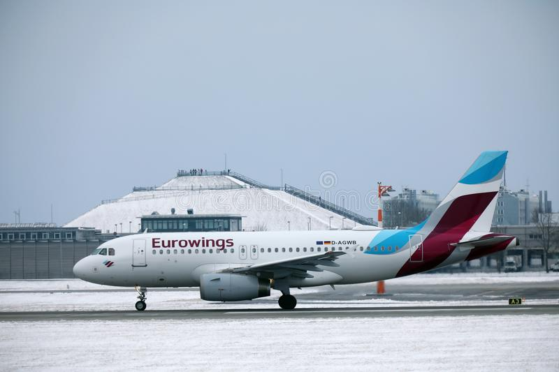Eurowings Airbus A319-100 D-AGWB landing in Munich Airport. Eurowings Airbus A319-100 D-AGWB landed in Munich Airport, winter time with snow on runway royalty free stock images