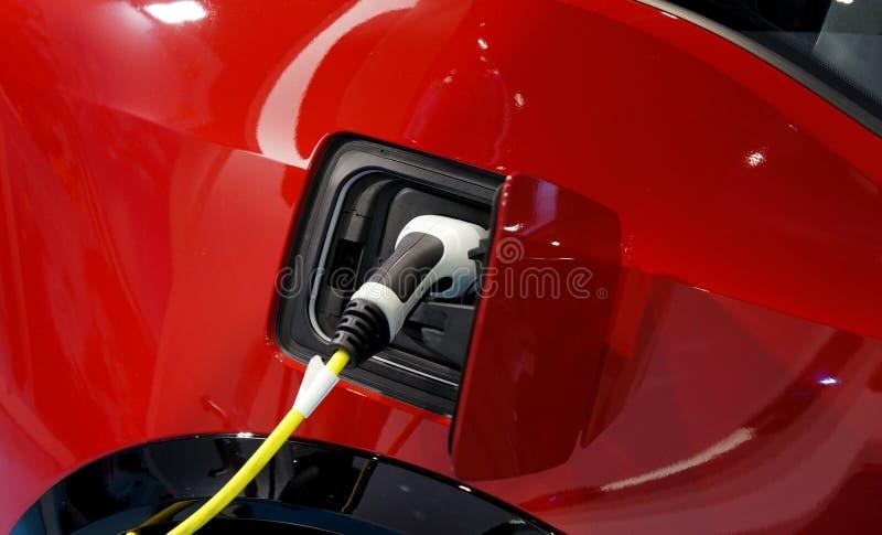EV汽车的电缆充电的电池插座  电车插口 免版税库存照片