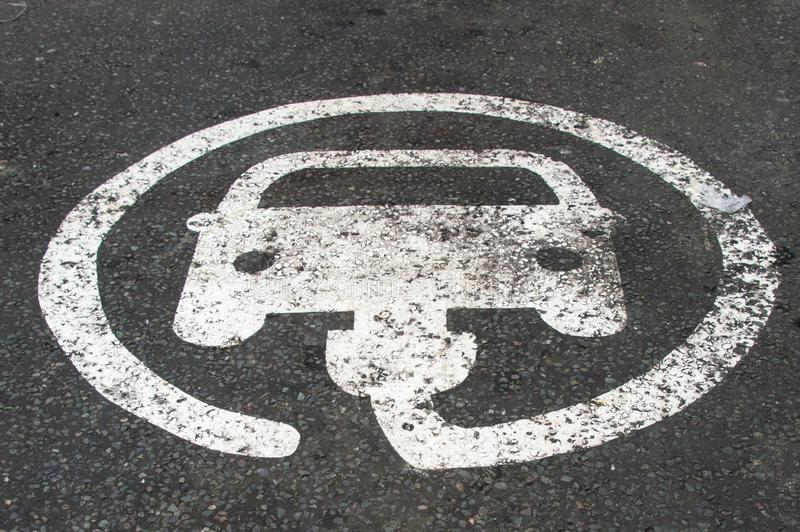 EV / Electric vehicle charging point marked on the parking bay stock images