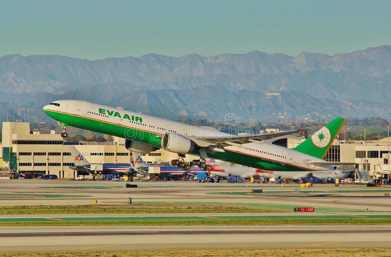 A Eva Air Boeing B-777 takes off from Los Angeles on a return flight to Taipie in 2015. A Eva Air Boeing B-777-36 B-16720 CN 41820 LN 1213 takes off from Los stock photos