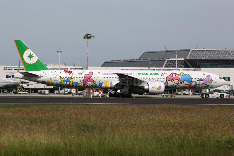 EVA Air Boeing 777-300ER Hello Kitty airplane Taipei Taoyuan Air. Taipei Taoyuan, Taiwan - October 20, 2015: An EVA Air Boeing B777-300 with the registration B stock images