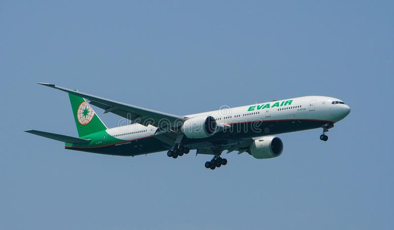 EVA Air Boeing 777-300ER Landing. In the afternoon at Changi Airport, Singapore royalty free stock photos