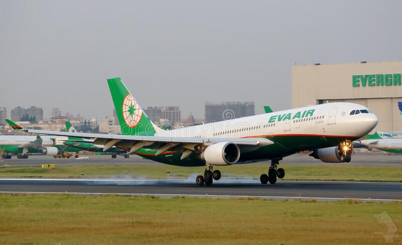 Eva Air jet landing on the runway royalty free stock images