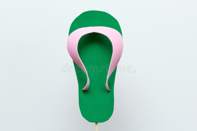 Eva foam green flip flops white background. Eva foam green flip flops on white background royalty free stock photo