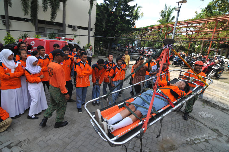 Evacuating victims of accidents from a height. Students to practice evacuating victims of accidents from a height using rope and dragbar in Surakarta, Indonesia stock photos