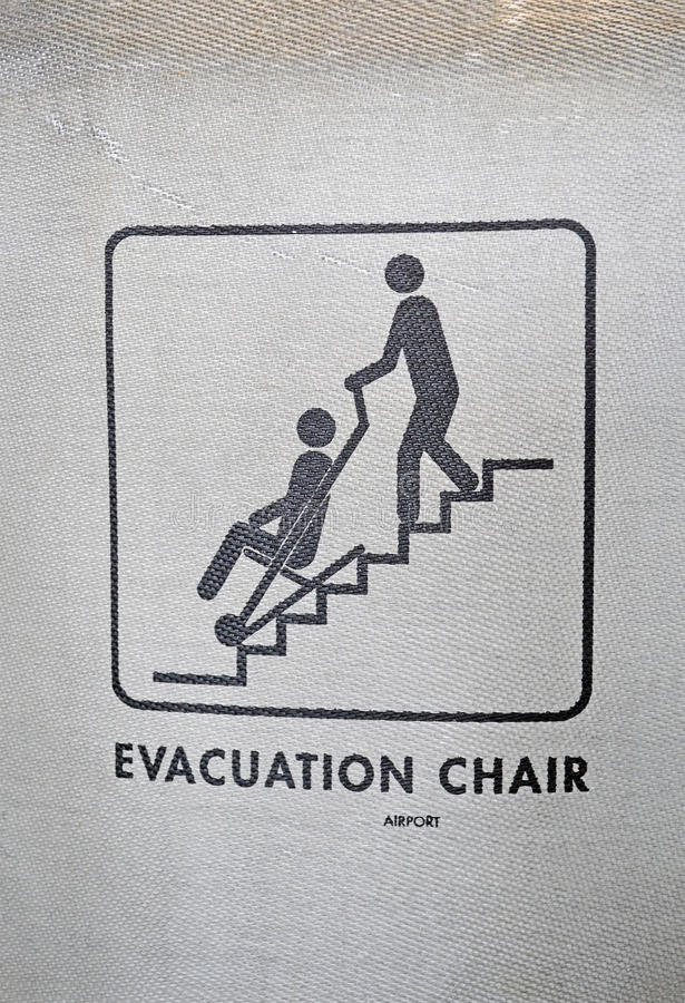 Evacuation chair sign on textured surface, help. Industry stock photography