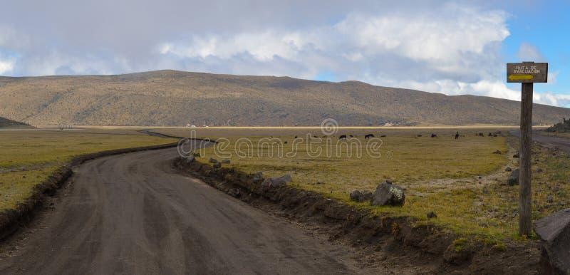 Evacuation route, cotopaxi national park. Sign of an evacuation route in cotopaxi national park volcano, ecuador stock image