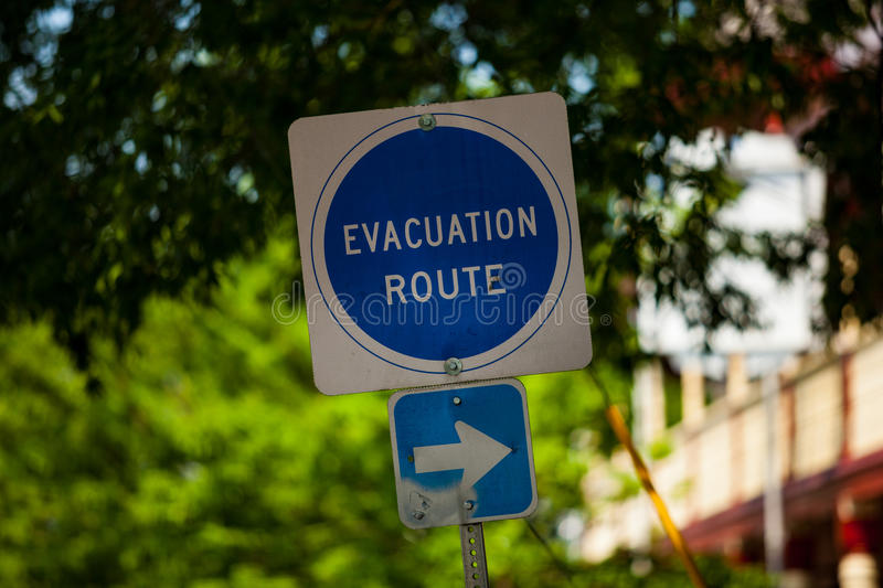 Evacuation Route Direction Sign. Newark, DE – June 24, 2013: An Evacuation Route sign in the downtown area of Newark royalty free stock photo