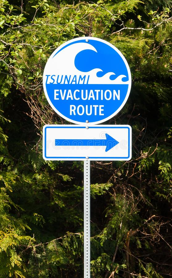 Evacuation Route Highway sign in Vancouver Island. A highway sign marking Tsunami Evacuation Route in Vancouver Island - British Columbia, Canada royalty free stock image