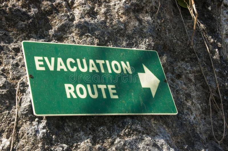 Evacuation route sign. Green evacuation route sign photo stock images