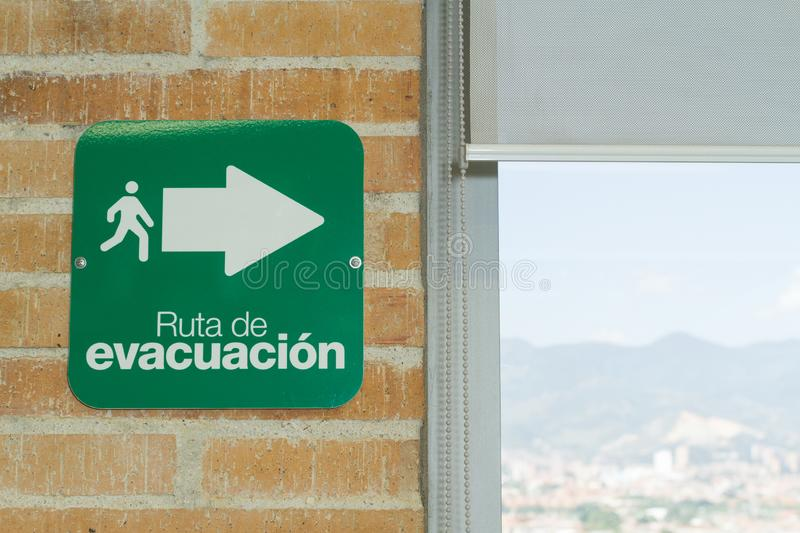 Evacuation route sign, text in spanish.  royalty free stock photos