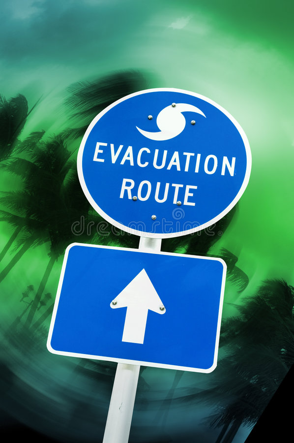 Evacuation sign. Hurricane evacuation sign with swirling palm tree background stock images