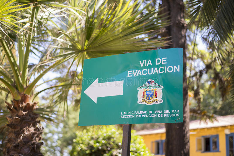 Evacuation sign. In Spanish language at Vina Del Mar, Chile royalty free stock image