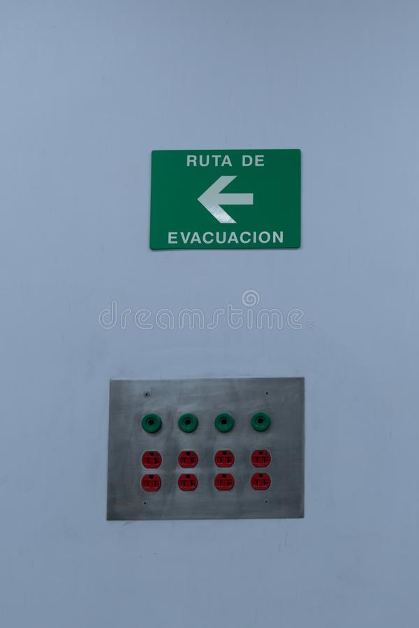 Evacuation signaling and electrical power contact board green and red. Evacuation signaling and electrical power contact board Green and royalty free stock photos