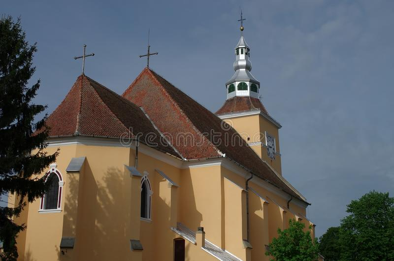 Fortified church of Halchiu - heldsdorf. The evangelical church in Halchiu it was built in the 13th century. In the church is found the largest medieval altar in royalty free stock images