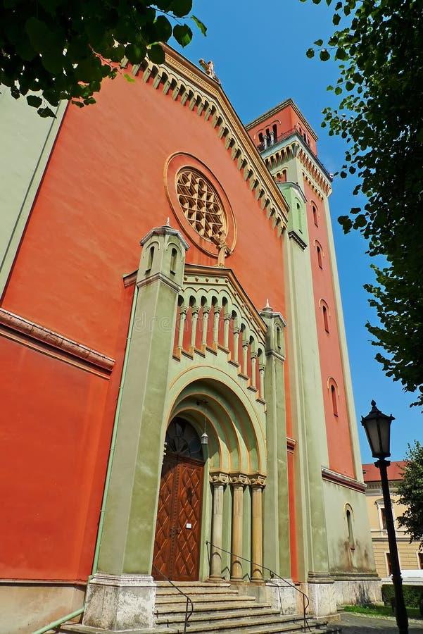 Evangelical Church in  Kezmarok, Slovakia. View of Entrance of Evangelical Church with park and street light in Kezmarok, Slovakia royalty free stock photo