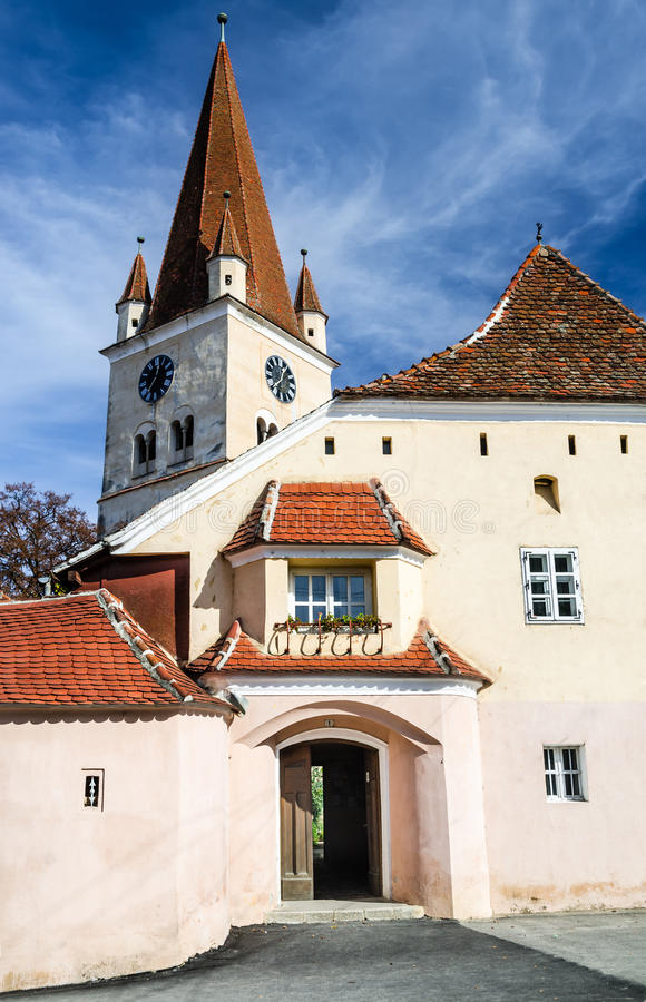 Evangelical Fortified Church in Cisnadie, Romania. Three-nave fortified Evangelical Church Cisnadie, built in 1349 honor of Saint Walpurga. Sibiu County stock images