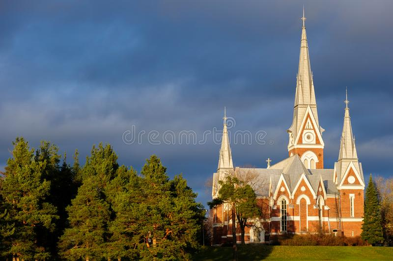 Evangelical Lutheran Church of Joensuu, Finland. Dramatic sky in evening light royalty free stock image