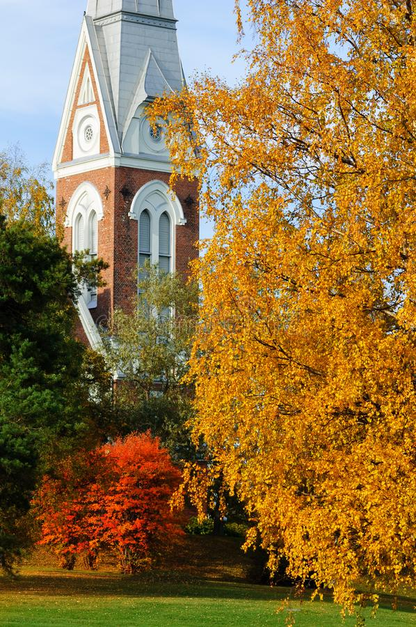 Evangelical Lutheran Church of Joensuu, Finland. Trees in autumn colors royalty free stock photography