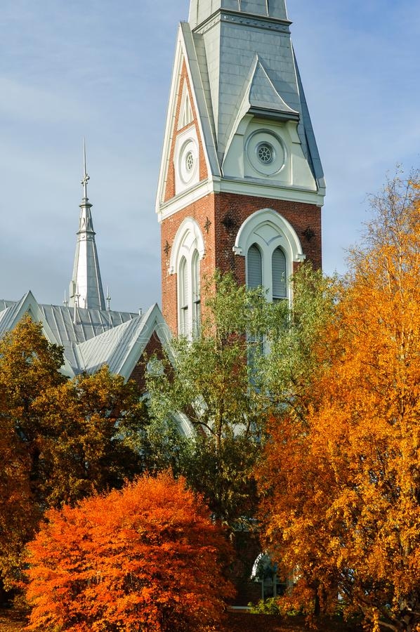 Evangelical Lutheran Church of Joensuu, Finland. Trees in autumn colors stock photography
