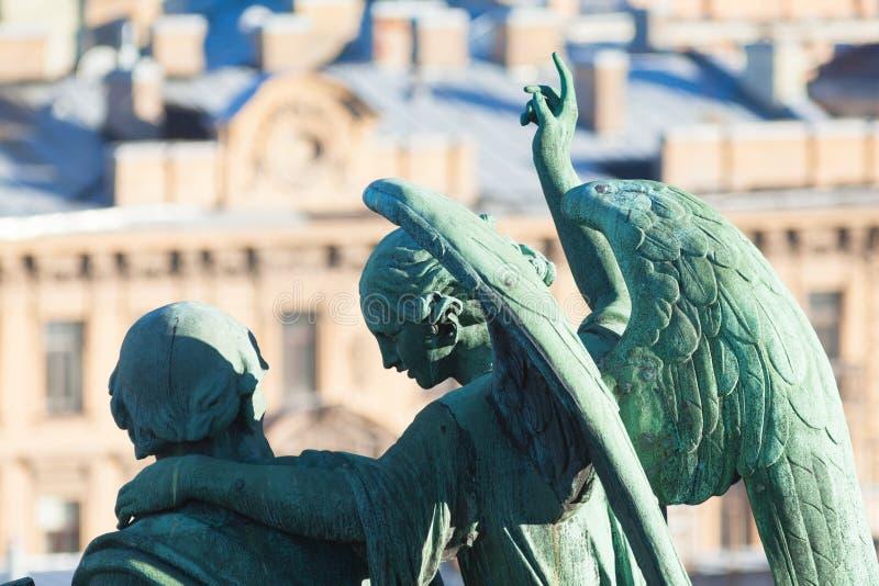 Evangelist Matthew en engel stock afbeeldingen