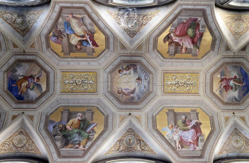 The evangelists, fresco on the ceiling of Santa Maria in Aquiro church in Rome. Italy royalty free stock photo
