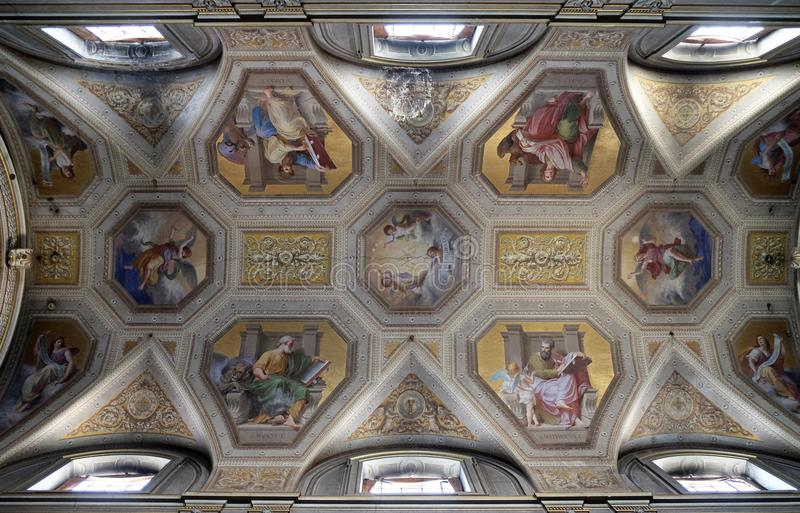 The evangelists, fresco on the ceiling of Santa Maria in Aquiro church in Rome. Italy stock photo