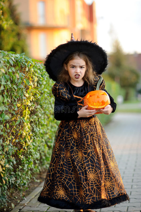Eve of All Saints Day. Little girl portrays the evil enchantress. royalty free stock photos