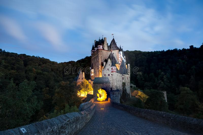 Ghostly Eltz Castle whit light painting royalty free stock photo