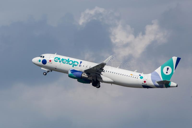 Evelop airlines airplane starting at budapest airport hungary. Budapest, budapest/hungary - 24 04 18: evelop airlines airplane starting at budapest airport stock images
