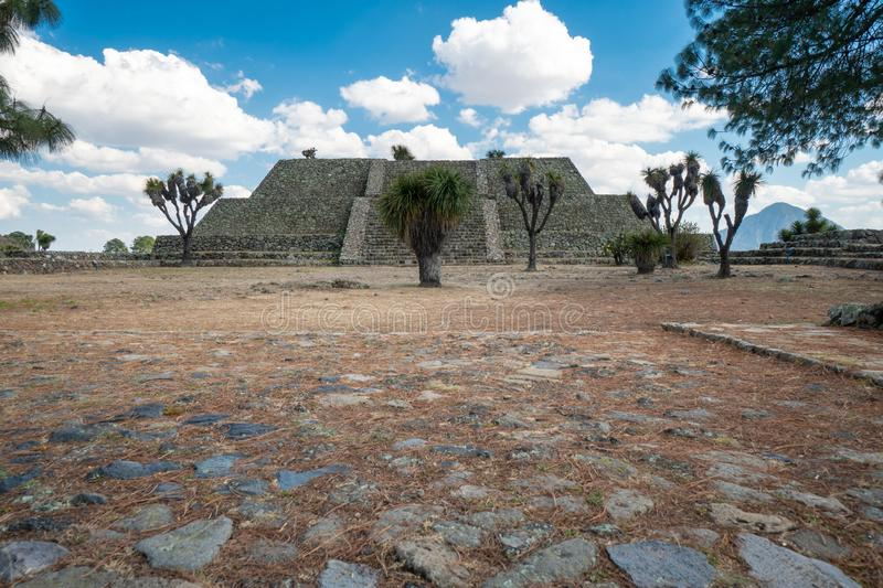 Cantona, Puebla, Mexico - a mesoamerican archaeoligical site with only few visitors. Even though Cantona can be reached by public transport on a day trip from stock photography