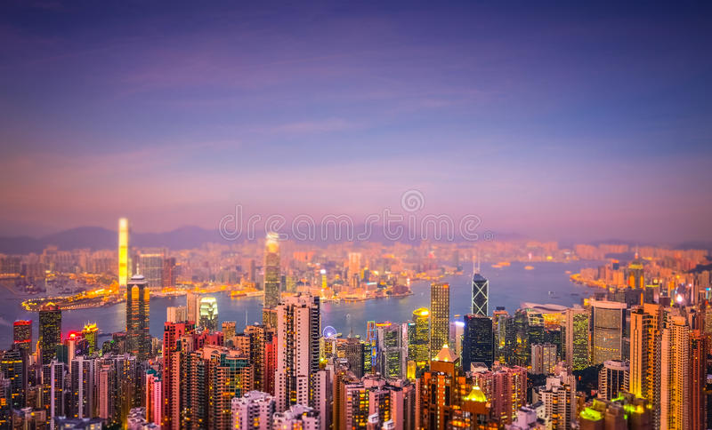 Evening aerial view panorama of Hong Kong. Tilt shift effect. Evening aerial view panorama of Hong Kong skyline and Victoria Harbor. Travel destinations. Tilt royalty free stock images