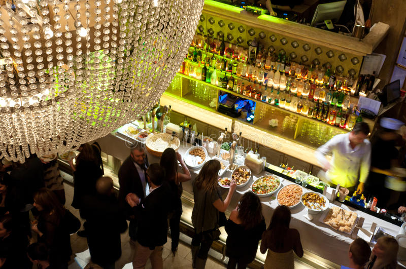 Evening aperitif. A rich buffet aperitif all you can eat is more than a tradition for milanese clubs like the elegant Il Gattopardo royalty free stock image