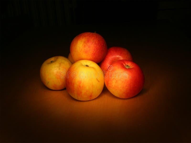 Evening apples still life. On dark background royalty free stock photo