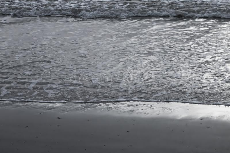 Evening beach with light waves.  royalty free stock image