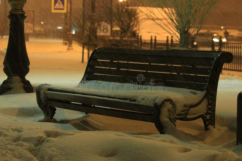 Evening blizzard over the bench stock images