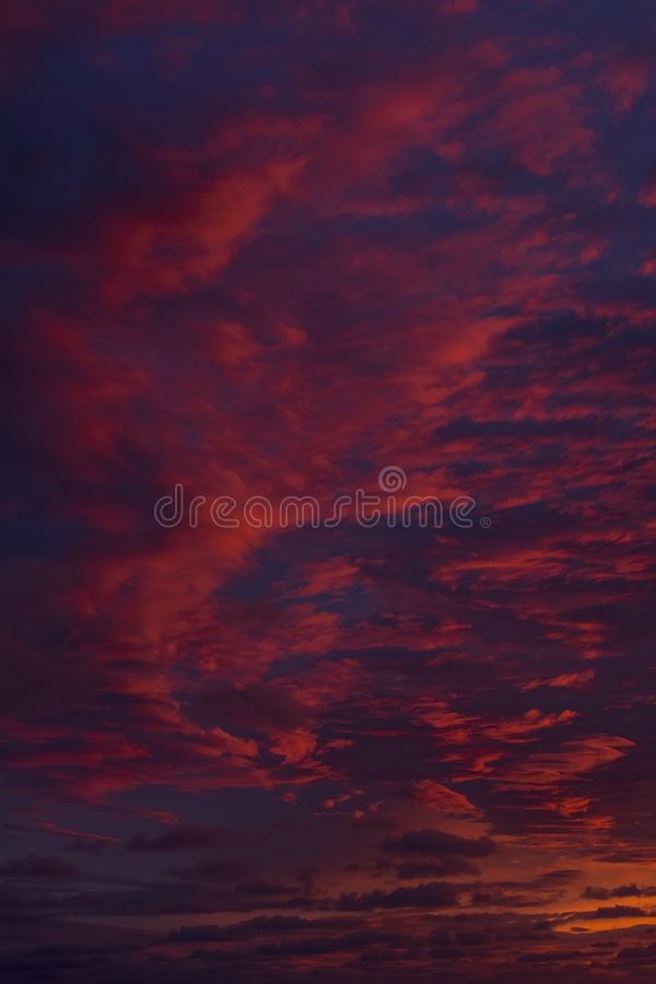 Evening blue and red sky with clouds stock images