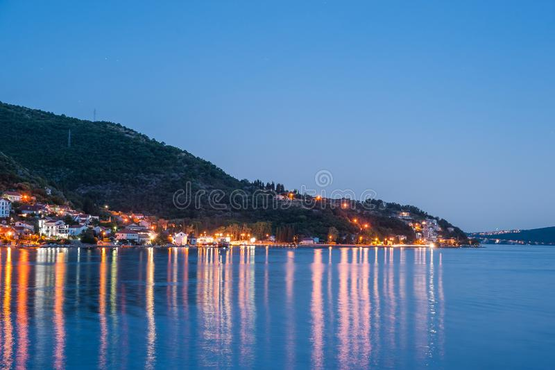 Evening at Boka Kotorska bay. With lanterns, travel landscape, Dobrota, Montenegro stock image