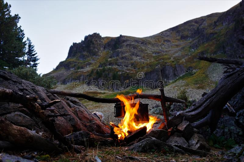 Evening, bonfire against the background of a mountain. royalty free stock images