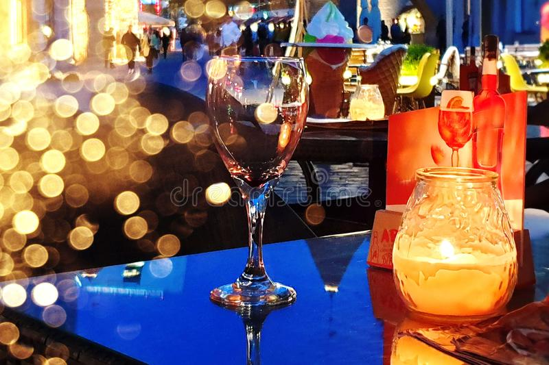 Evening cafe glass of wine on table candle light street cafe in old  town of Tallinn   city life background light night royalty free stock images