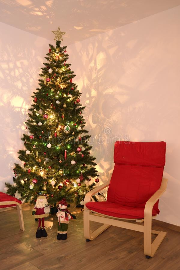 An evening by the Christmas Tree royalty free stock photography
