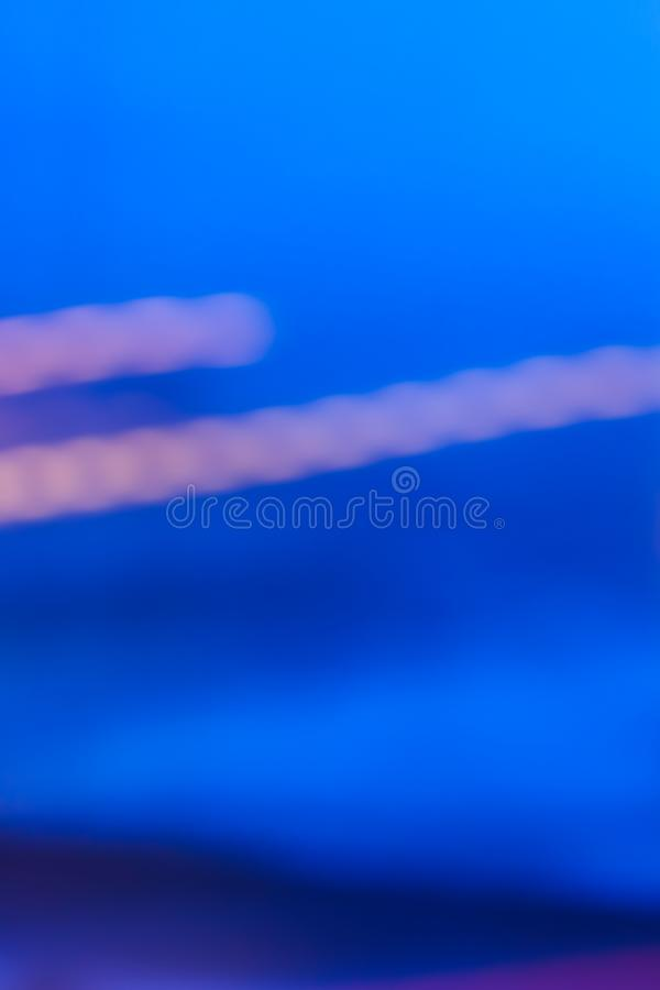 Evening city lights in motion. Abstract background, defocused textures and modern design concept - Evening city lights in motion stock illustration