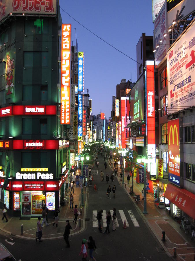 Evening city shops neon lights in central Tokyo. Shinjuku, Japan royalty free stock image